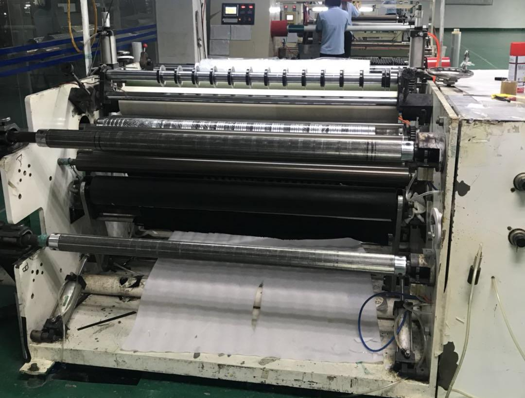 Multifunctional slitting and laminating rewinding